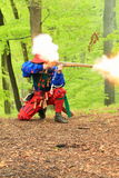 Landsknecht shooting from arkebusa Royalty Free Stock Images