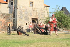 Landsknecht soldier getting ready for shooting from hand gun Royalty Free Stock Images