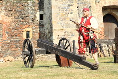 Landsknecht soldier getting ready for shooting from hand gun Royalty Free Stock Photography
