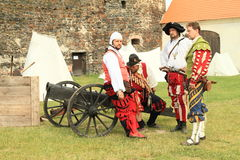 Landsknecht soldiers by a cannon Royalty Free Stock Photo
