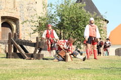 Landsknecht soldiers getting ready for shooting from cannon Stock Photography