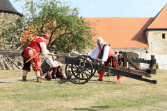 Landsknecht soldiers getting ready for shooting from cannon Stock Photo