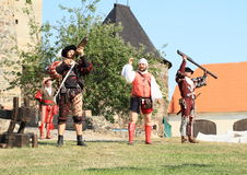 Landsknecht soldiers getting ready for shooting from hand guns Stock Photo