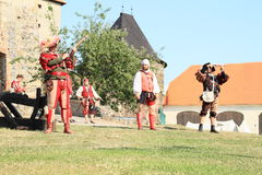 Landsknecht soldiers getting ready for shooting from hand guns Royalty Free Stock Images