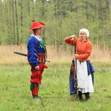 Landsknecht woman shooting from arkebusa Stock Photos
