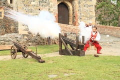 Landsknechts shooting from cannon Royalty Free Stock Photos