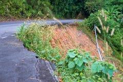 Landslide. Danger landslide on the asphalt road Royalty Free Stock Photography