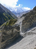 Landslide area, eroded rocks and Tilicho peak, Nepal Stock Photos