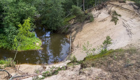 Landslide on the bank of the river Stock Photo