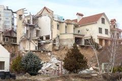 Landslide caused by rains of hurricane destroyed expensive cottages and houses. Destroyed house, cottage, large cracks, chips,. Slabs. Broken asphalt shifted stock photography