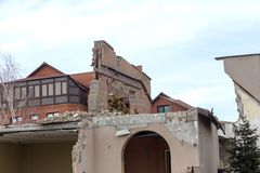 Landslide caused by rains of hurricane destroyed expensive cottages and houses. Destroyed house, cottage, large cracks, chips,. Slabs. Broken asphalt shifted stock photo