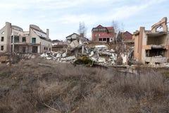 Landslide caused by rains of hurricane destroyed expensive cottages and houses. Destroyed house, cottage, large cracks, chips,. Slabs. Broken asphalt shifted stock photos