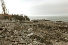 Landslide caused by rains of hurricane destroyed expensive cottages and houses. Destroyed house, cottage, large cracks, chips,. Slabs. Broken asphalt shifted royalty free stock photos