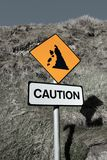 Landslide caution and warning road sign Royalty Free Stock Images