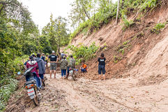 Landslide. CHIANG MAI, THAILAND - OCTOBER 4 :Peoples help together clear tree and soil on local road because of landslide on OCTOBER 4, 2009 in Omkoi,Chiang Mai Royalty Free Stock Photos