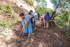 Landslide. CHIANG MAI, THAILAND - OCTOBER 4 :Peoples help together clear tree and soil on local road because of landslide on OCTOBER 4, 2009 in Omkoi,Chiang Mai Royalty Free Stock Photography