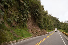 Landslide in the Colombian Andes. July 11, 2017 Tolima, Colombia: a vehicle is passing by a landslide in the mountains after a heavy rain Stock Photos