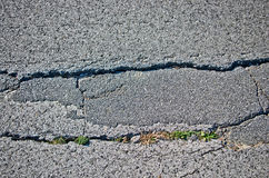 Landslide in country lane. Country road has a crack due to the landslide of the earth Royalty Free Stock Photo