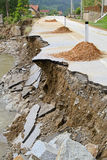 Landslide destruction. Destroyed road landslide damaged in powerful flood Stock Images
