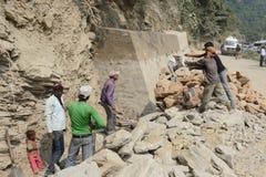 Landslide hazard at Rudraprayag of Garhwal Himalaya. After landslide labours working at the road in Rudraprayag.The Landslide hazard evaluation factor(LHEF) stock photos