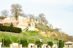 landslide over the embankment with walking people royalty free stock photo