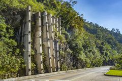 Landslide protection with reinforced concrete walls or spray concrete technic. Barrier for land slide stock photos
