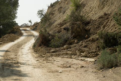 Landslide on a road. Country road in the aftermath of a major landslide Stock Images