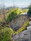 Landslide - road gone. Environmental degradation, extreme weathe Stock Photos