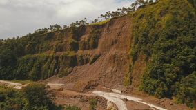 Landslide on the road in the mountains.Camiguin island Philippines. Landslides and rockfalls on the road in the mountains, Camiguin. Aerial view: mud and rocks Royalty Free Stock Photos