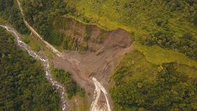 Landslide on the road in the mountains.Camiguin island Philippines. Landslides and rockfalls on the road in the mountains, Camiguin. Aerial view: mud and rocks Royalty Free Stock Images