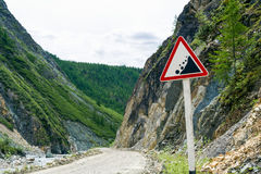 Landslide road sign in the mountains. A landslide warning road sign in the mountains Stock Photography