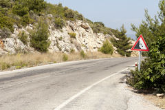 Landslide. Road warning sign landslide in country road Stock Photography
