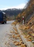Landslide of rocks on the asphalt road Royalty Free Stock Images