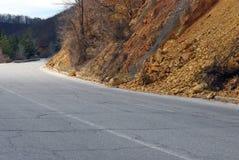 Landslide of rocks on the asphalt road Royalty Free Stock Photography