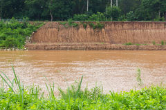 Landslides across the river. Royalty Free Stock Photo