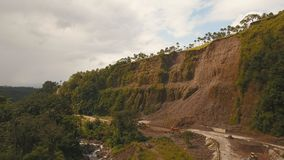 Landslide on the road in the mountains.Camiguin island Philippines. Landslides and rockfalls on the road in the mountains, Camiguin. Aerial view: mud and rocks Stock Image