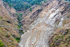 Landslides and rockfalls on the road in the mountains royalty free stock photo