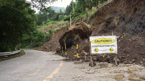 Landslide on the mountain road..Camiguin island Philippines. Landslides and rockfalls on the road in the mountains. Mud and rocks blocking the road.Destroyed Royalty Free Stock Photos