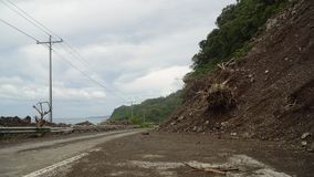 Landslide on the mountain road..Camiguin island Philippines. Royalty Free Stock Photography