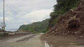 Landslide on the mountain road..Camiguin island Philippines. Royalty Free Stock Images
