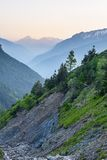 Landslides in scenic alpine valley at dusk Royalty Free Stock Image