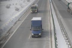 Landstraße im Blizzard Lizenzfreies Stockfoto