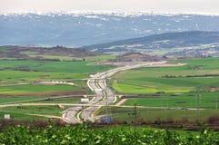 Landstraße mit Straßenkurven Stockbild