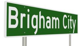 Landstraßenzeichen für Brigham City Utah Stockbild