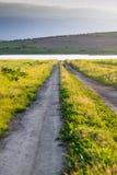 Landsväg till sjön Royaltyfria Foton