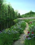 Landsvägen passerar till och med äng nära en flod Arkivfoto