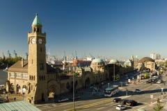 Landungsbruecken Piers in Hamburg. HAMBURG, GERMANY - OCTOBER 11, 2015: Famous Hamburger Landungsbruecken with commercial harbor and Elbe river, St. Pauli royalty free stock images