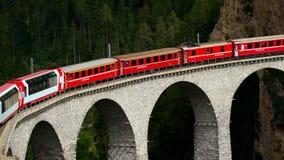 Landwasser viaduct, Switzerland - AUG 30, 2017: The train passes through the famous Landwasser viaduct in Switzerland. The train passes through the famous stock video footage