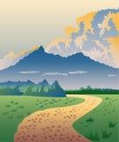 Landweg met bergen Stock Fotografie