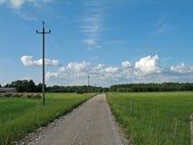 Landweg op een duidelijke dag Royalty-vrije Stock Foto